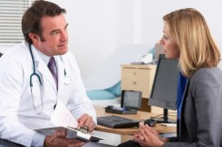 Консультация с врачом при болях в спине
