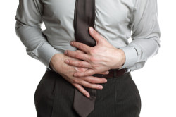 Заболевания желудка как причина боли в пояснице
